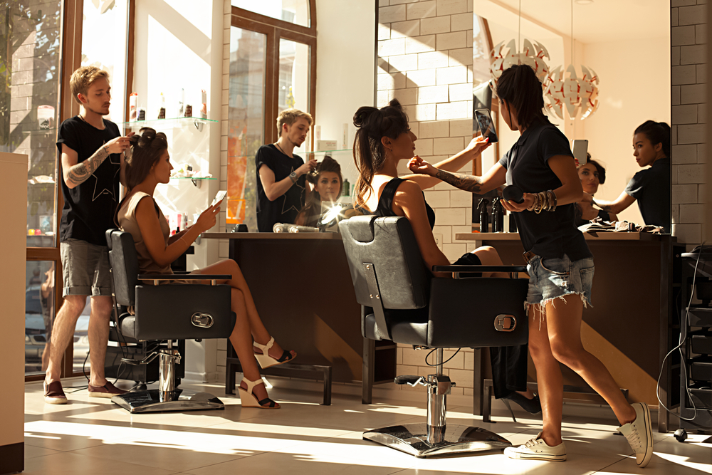hair salon with customers and workers
