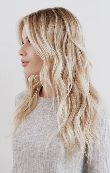girl with blonde beach waves