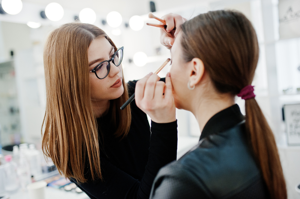 makeup artist working with client