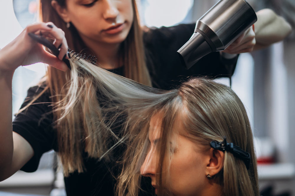 hairstylist helping client with hair