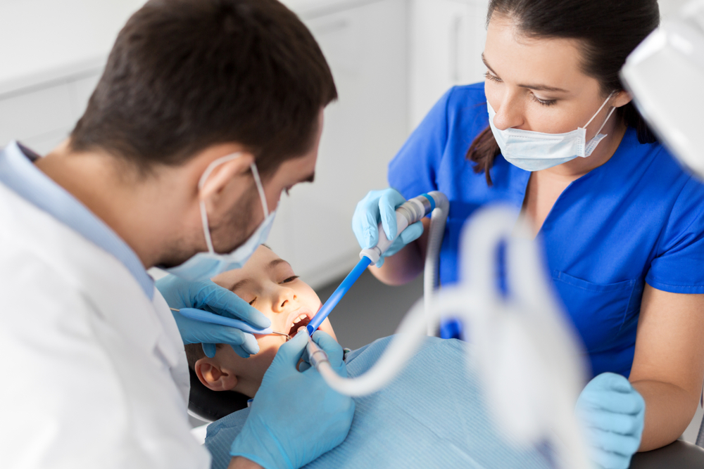 dental assistants working with patient
